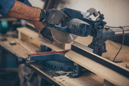 woodworker using router table