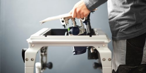man assembling power tools